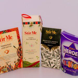 Stir Me Luxury Tea, Black Tea in Tea Bags, Black Loose Tea and a packet of Cadbury Heroes Chocolate
