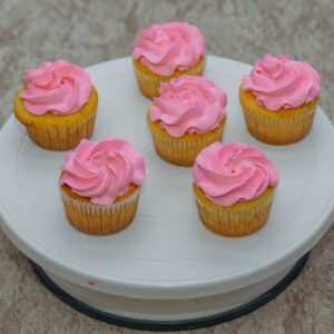Orange Cupcakes with Pink Vanilla Frosting